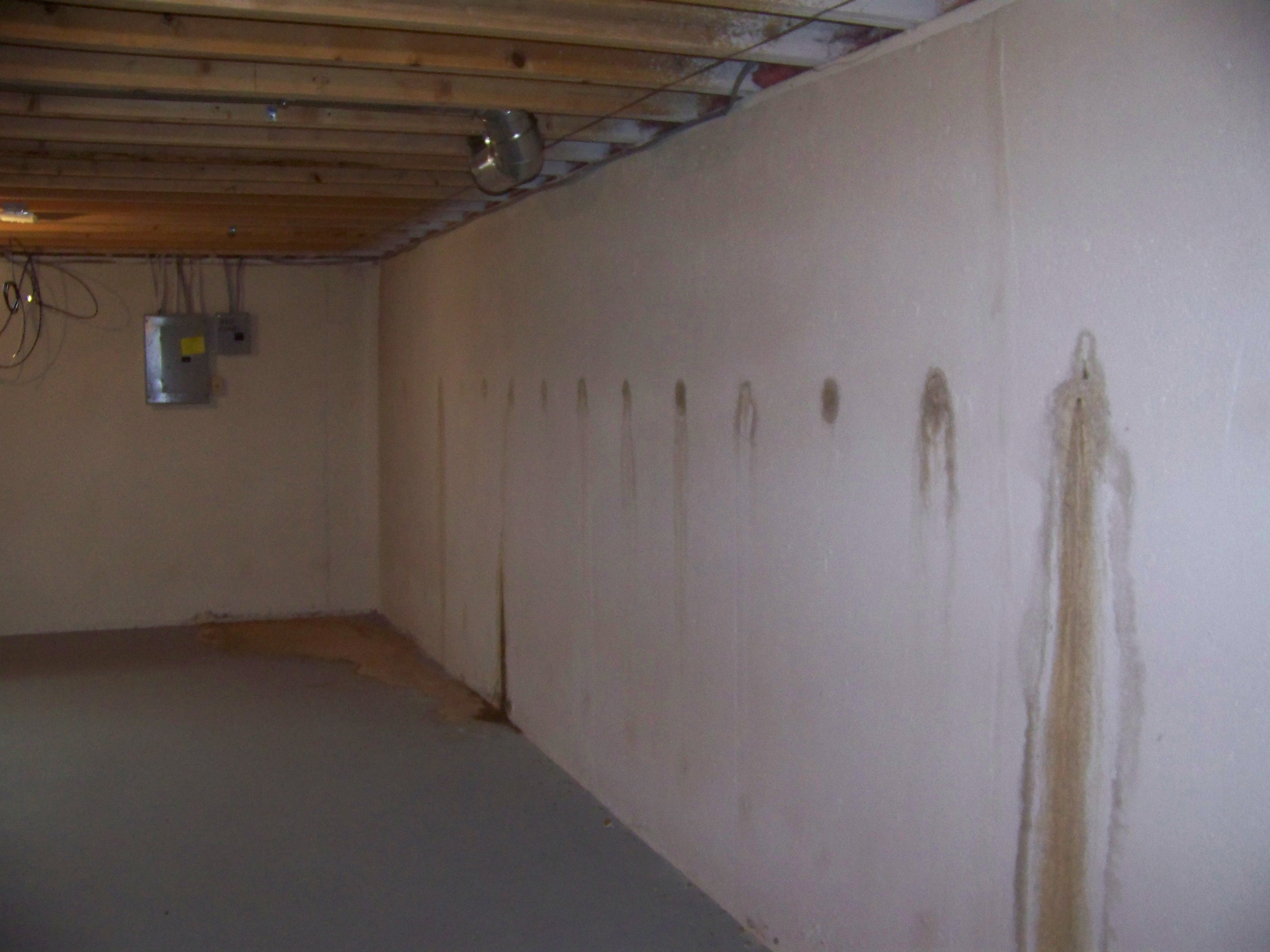 American homes and gardens basement leaks for Poured basement walls